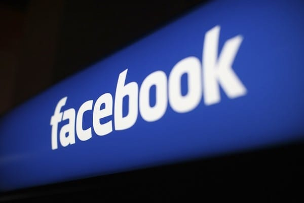 The Facebook logo is pictured at the Facebook headquarters in Menlo Park, California, in this January 29, 2013 file photo. Facebook Inc advertising business grew at its fastest clip since before the company's May initial public offering, helping the company's revenue expand 40 percent to $1.585 billion. REUTERS/Robert Galbraith/Files (UNITED STATES - Tags: BUSINESS LOGO)
